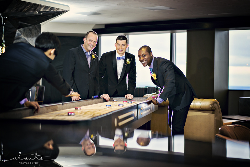 Groomsmen playing shuffleboard at Columbia Tower Club