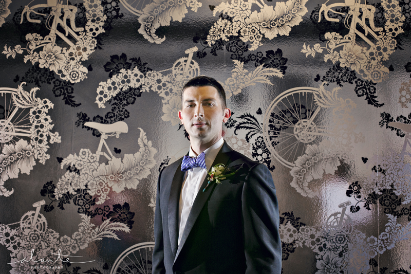 Groom at the Columbia Tower Club with Metallic Wallpaper