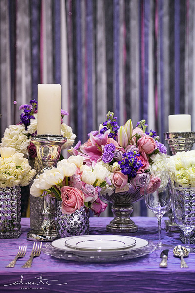 Purple and silver wedding details with a ribbon background