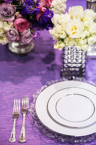 Purple and silver wedding with mercury glass vases