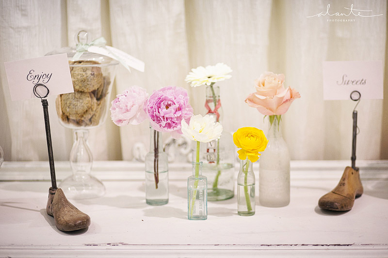 Single stem wedding flowers with vintage shoe forms