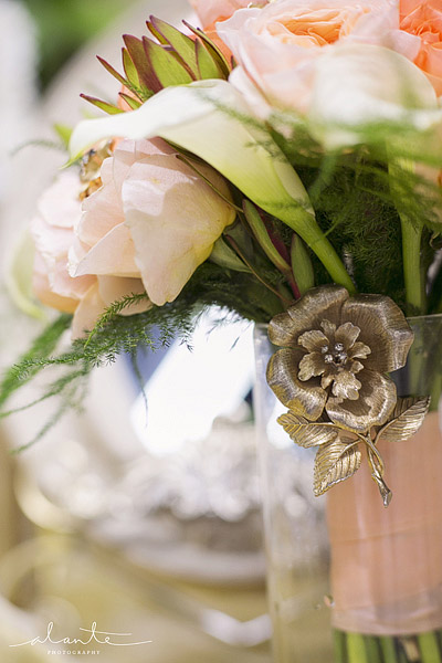Peach bridal bouquet with a vintage gold brooch
