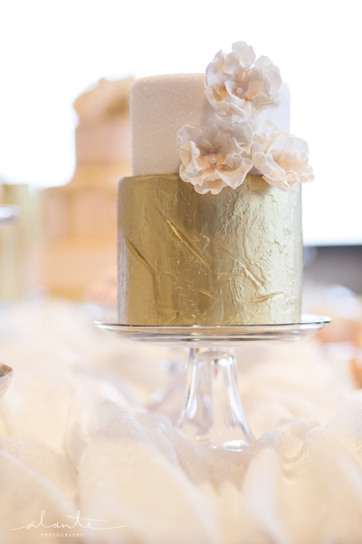 white peach and gold wedding cake and gold wedding details alante photography 27306